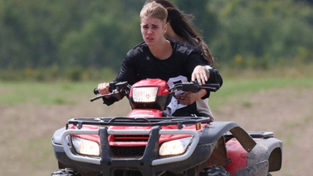 Justin Bieber riding ATV that collides with a minivan last Friday and leaves The Beebs with 2 more charges against him.
