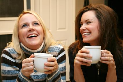 Friends enjoy a hot cup of coffee in the kitchen